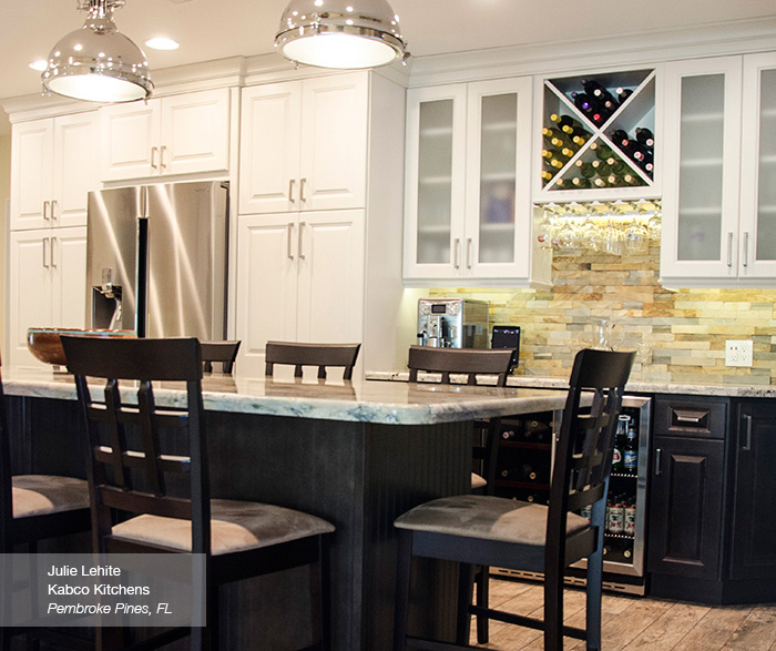 Montella off white cabinets in French Vanilla with a dark kitchen island in Buckboard
