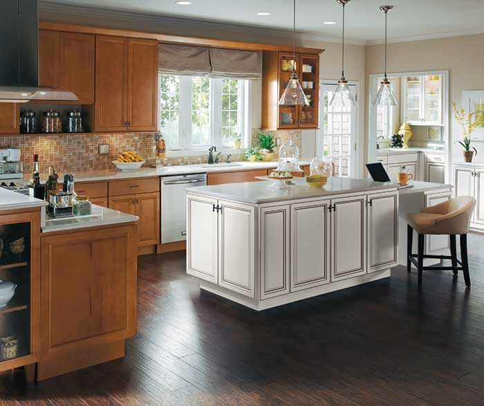 Warm Maple wood cabinets with a white kitchen island